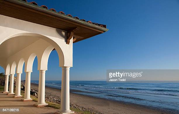 Structure with arches and spanish tile on beach