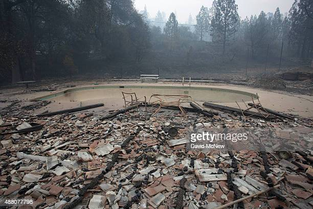 Structures around a pool lie in ruins after the Butte Fire destroyed the Golden Spur mini market north of Murphys California on September 13 2015...