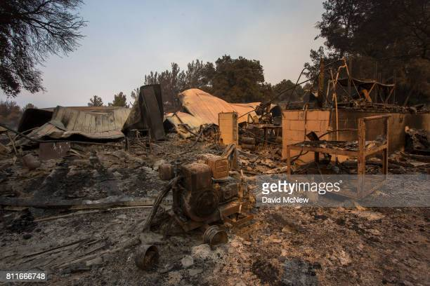 Structures at Rancho Alegre Boy Scouts of America outdoor school are left in ruins after the Whittier Fire swept through on July 9 2017 near Santa...