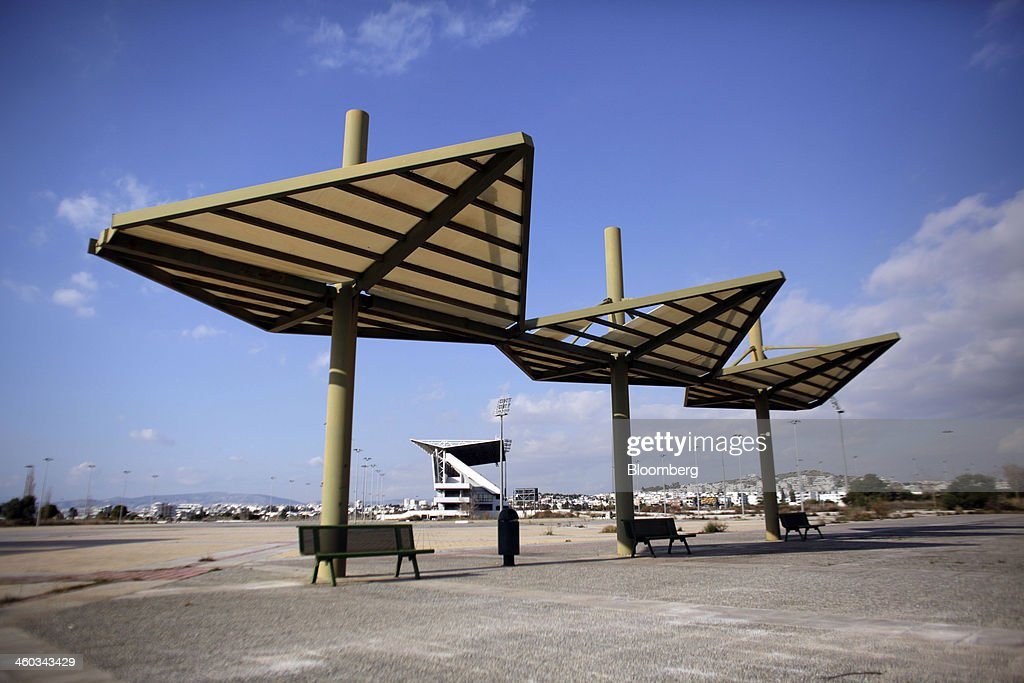 Structures stand in the abandoned Olympic softball field at the former Athens International Airport in the Hellenikon district of Athens, Greece, on Friday, Dec. 3, 2014. Hellenikon is the largest of Greece's land development projects, three times the size of the Principality of Monaco. Photographer: Kostas Tsironis/Bloomberg via Getty Images