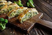 Savory strudel stuffed with broccoli, Mozzarella cheese and onion