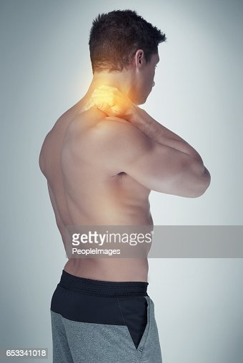 Struggling with a stiff and sore neck : Stockfoto