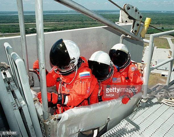 Sts96 Mission Specialists Valery Ivanovich Tokarev Julie Payette And Ellen Ochoa Wait In The Slidewire Basket At Launch Pad 39B To Practice Emergency...