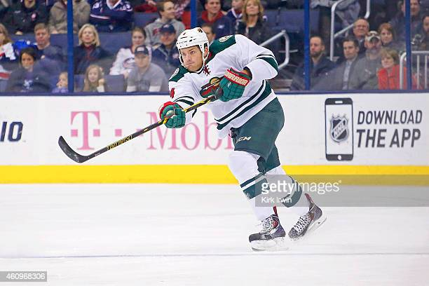 Stu Bickel of the Minnesota Wild controls the puck during the game against the Columbus Blue Jackets on December 31 2014 at Nationwide Arena in...