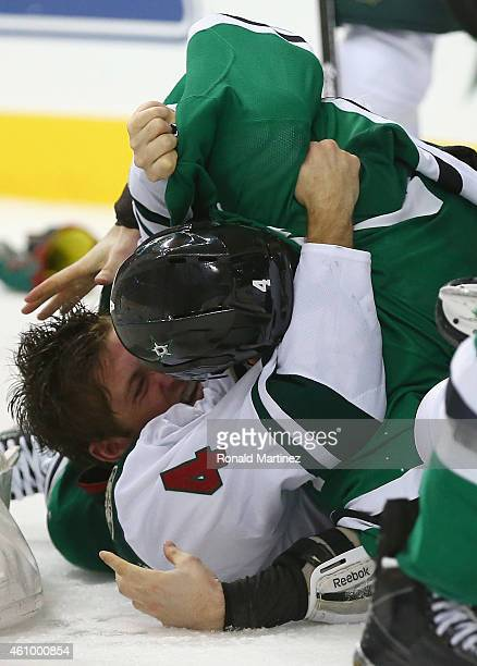 Stu Bickel of the Minnesota Wild fights with Jason Demers of the Dallas Stars in the second period at American Airlines Center on January 3 2015 in...