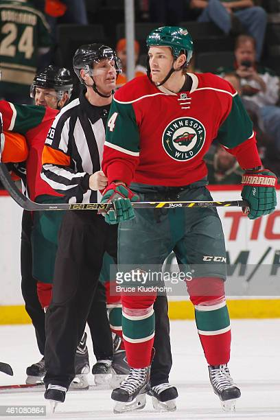 Stu Bickel of the Minnesota Wild is pulled aside by an official during the game against the Philadelphia Flyers on December 23 2014 at the Xcel...
