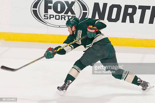 Stu Bickel of the Minnesota Wild shoots the puck against the Winnipeg Jets during the game on December 27 2014 at the Xcel Energy Center in St Paul...