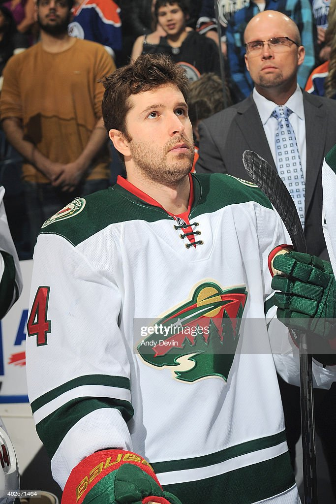 <a gi-track='captionPersonalityLinkClicked' href=/galleries/search?phrase=Stu+Bickel&family=editorial&specificpeople=4862669 ng-click='$event.stopPropagation()'>Stu Bickel</a> #4 of the Minnesota Wild stands for the singing of the national anthem prior to the game against the Edmonton Oilers on January 27, 2015 at Rexall Place in Edmonton, Alberta, Canada.