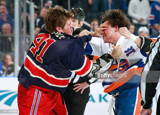 Stu Bickel of the New York Rangers fights against Micheal Haley of the New York Islanders at Madison Square Garden on March 11 2012 in New York City