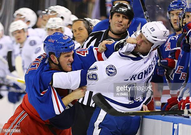 Stu Bickel of the New York Rangers fights with BJ Crombeen of the Tampa Bay Lightning during their game at Madison Square Garden on February 28 2013...