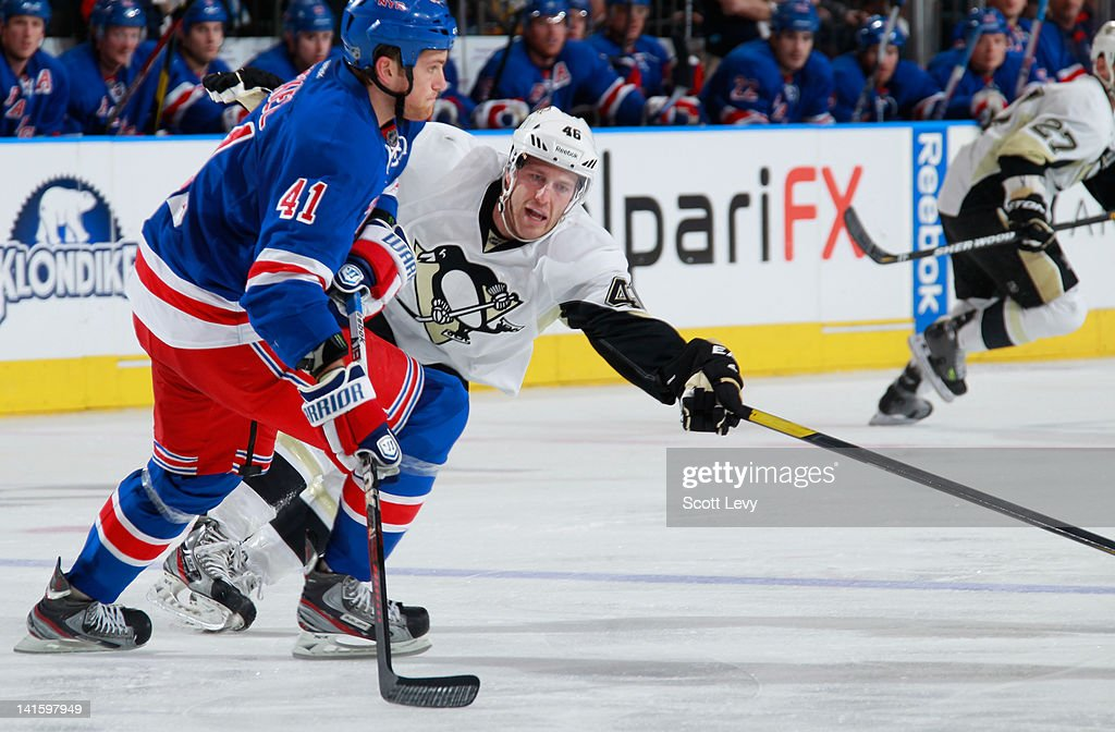 <a gi-track='captionPersonalityLinkClicked' href=/galleries/search?phrase=Stu+Bickel&family=editorial&specificpeople=4862669 ng-click='$event.stopPropagation()'>Stu Bickel</a> #41 of the New York Rangers skates against <a gi-track='captionPersonalityLinkClicked' href=/galleries/search?phrase=Joe+Vitale+-+Ice+Hockey+Player&family=editorial&specificpeople=10837805 ng-click='$event.stopPropagation()'>Joe Vitale</a> #46 of the Pittsburgh Penguins at Madison Square Garden on March 15, 2012 in New York City.