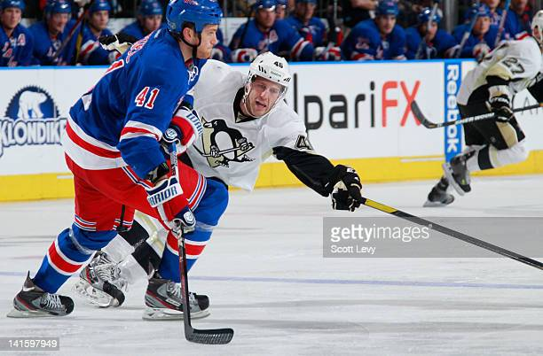 Stu Bickel of the New York Rangers skates against Joe Vitale of the Pittsburgh Penguins at Madison Square Garden on March 15 2012 in New York City