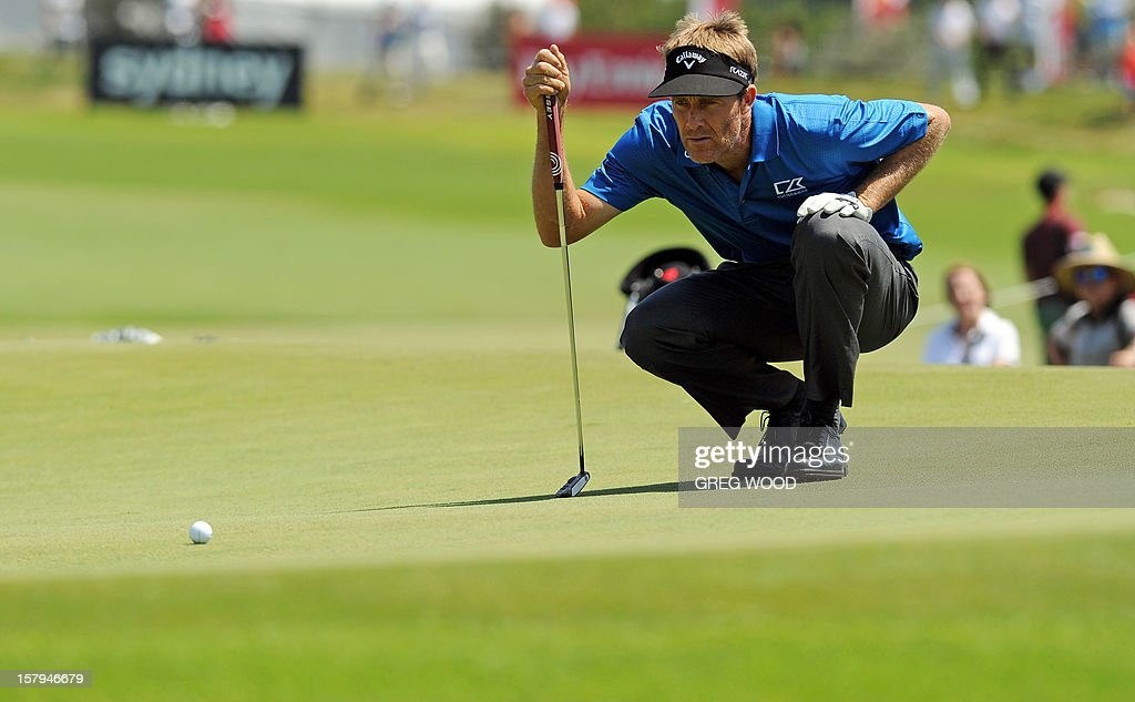 Stuart Appleby from Australia lines up a putt on the 17th green during round three of the Australian Open golf at The Lakes course in Sydney on December 8, 2012. IMAGE STRICTLY RESTRICTED TO EDITORIAL USE - STRICTLY NO COMMERCIAL USE AFP PHOTO / Greg WOOD