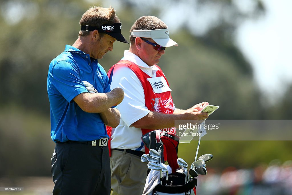 Stuart Appleby of Australia chats to his caddie during round three of the 2012 Australian Open at The Lakes Golf Club on December 8, 2012 in Sydney, Australia.
