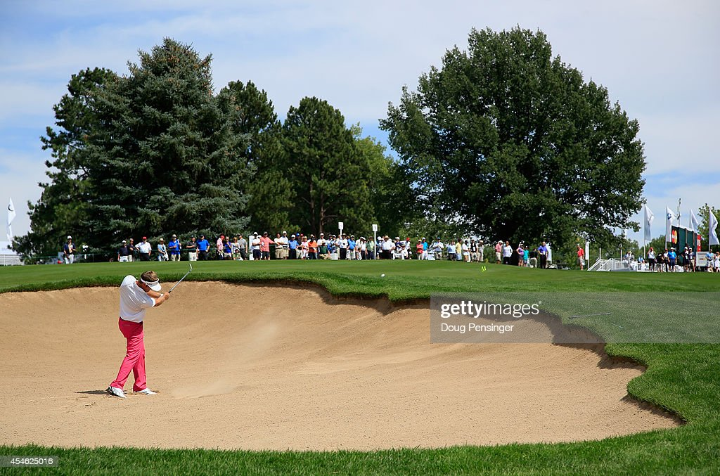 Stuart Appleby of Australia hits a bunker shot on the ninth hole during the first round of the BMW Championship at the Cherry Hills Country Club on...