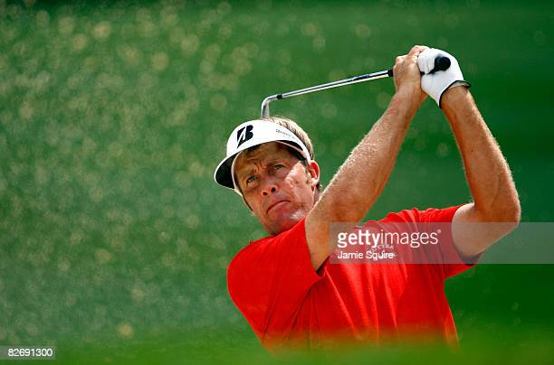 Stuart Appleby of Australia hits his second shot from a trap on the 7th hole during the second round of the BMW Championship on September 6 2008 at...