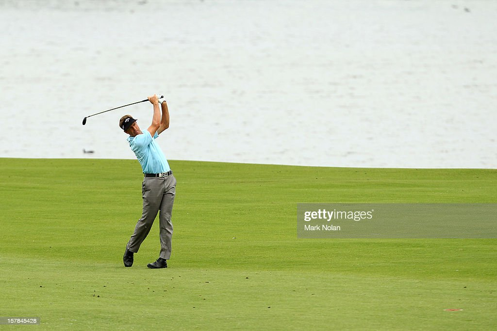 <a gi-track='captionPersonalityLinkClicked' href=/galleries/search?phrase=Stuart+Appleby&family=editorial&specificpeople=183401 ng-click='$event.stopPropagation()'>Stuart Appleby</a> of Australia plays a fairway shot during round two of the 2012 Australian Open at The Lakes Golf Club on December 7, 2012 in Sydney, Australia.