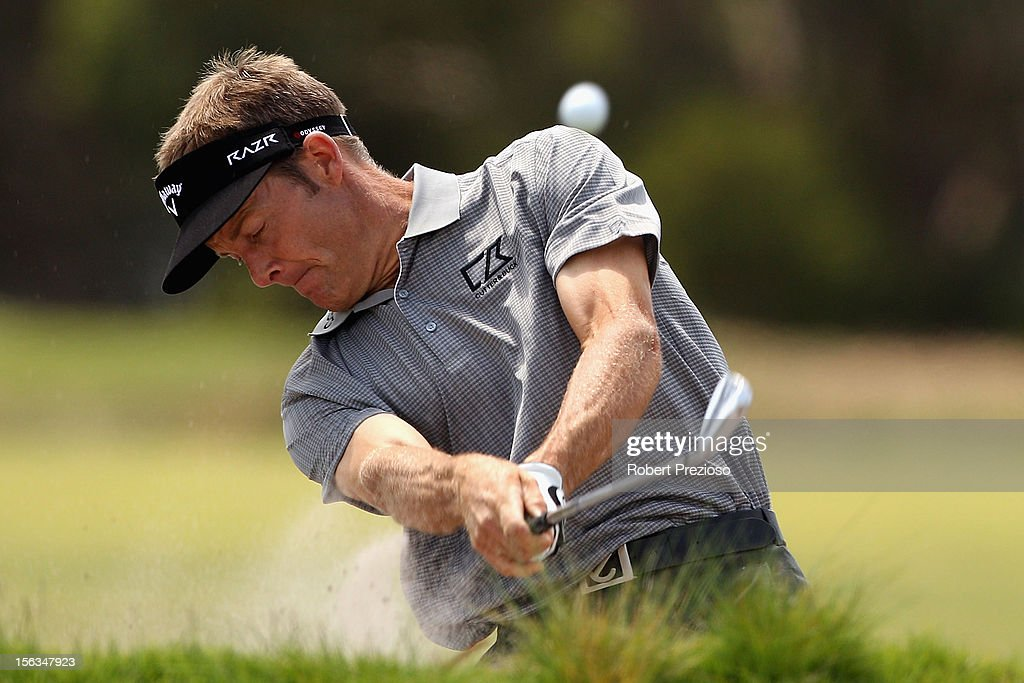 <a gi-track='captionPersonalityLinkClicked' href=/galleries/search?phrase=Stuart+Appleby&family=editorial&specificpeople=183401 ng-click='$event.stopPropagation()'>Stuart Appleby</a> of Australia plays a shot out of the bunker ahead of the 2012 Australian Masters at Kingston Heath Golf Club on November 14, 2012 in Melbourne, Australia.