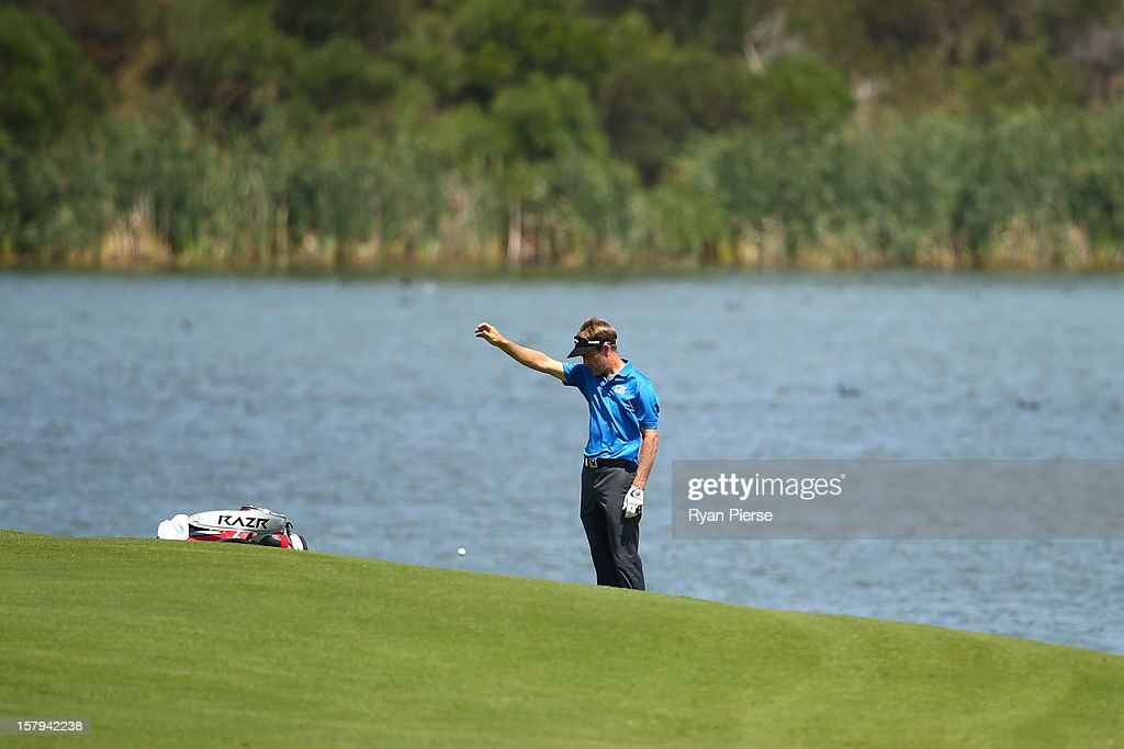 Stuart Appleby of Australia takes a drop during round three of the 2012 Australian Open at The Lakes Golf Club on December 8, 2012 in Sydney, Australia.