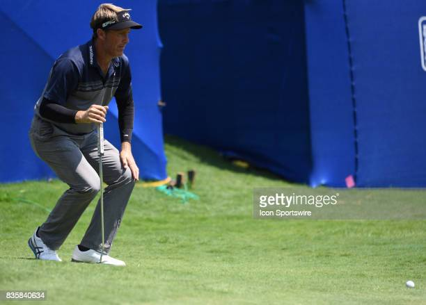 Stuart Appleby reads his putt line on the 15th hole during the third round of the Wyndham Championship on August 19 2017 at Sedgefield Country Club...