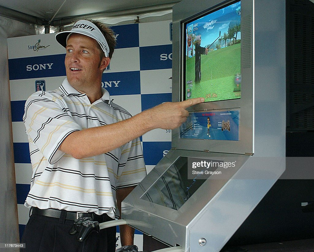 Stuart Appleby takes time out to play 'Hot Shots 4' on the Sony Playstation 2 at the Pro-Am event at the 2004 Sony Open.