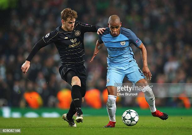 Stuart Armstrong of Celtic and Fernando of Manchester City battle for possession during the UEFA Champions League Group C match between Manchester...