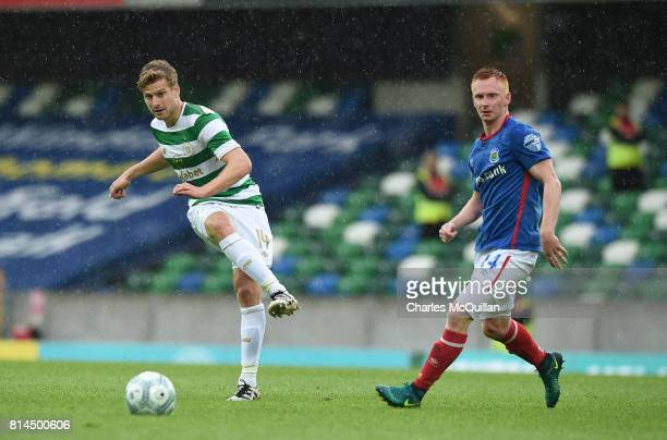 Stuart Armstrong of Celtic and Robert Garrett of Linfield during the Champions League second round first leg qualifying game between Linfield and...