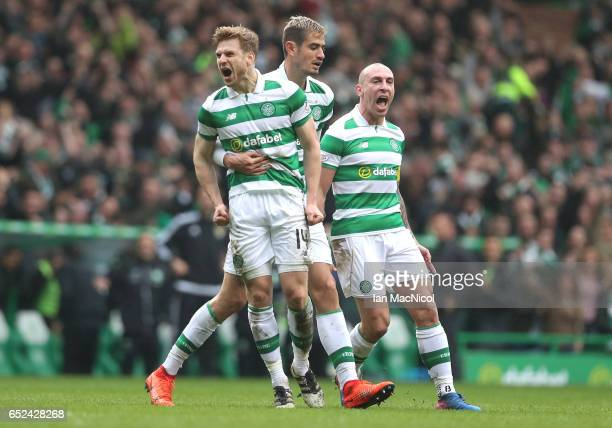 Stuart Armstrong of Celtic celebrates scoring his sides first goal with his Celtic team mates during the Ladbrokes Scottish Premiership match between...