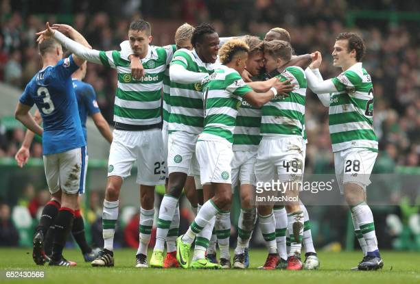 Stuart Armstrong of Celtic celebrates scoring his sides first goal with James Forrest of Celtic and the rest of his Celtic team mates during the...