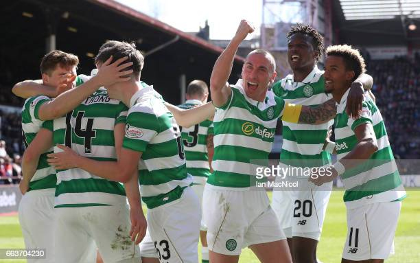Stuart Armstrong of Celtic celebrates scoring his sides third goal with his Celtic team mates during the Ladbrokes Scottish Premiership match between...
