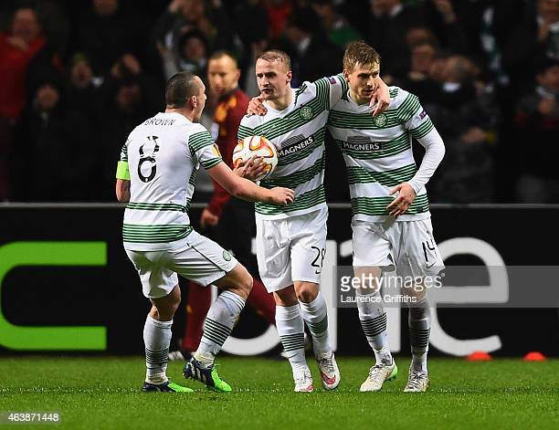 Stuart Armstrong of Celtic celebrates with team mates Scott Brown and Leigh Griffiths as he scores their first goal during the UEFA Europa League...