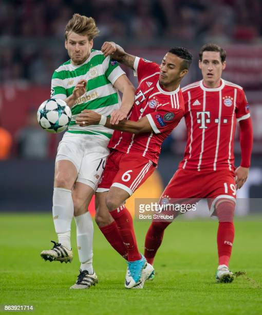 Stuart Armstrong of Celtic FC is challenged by Thiago Alcantara of FC Bayern Muenchen during the UEFA Champions League group B match between Bayern...
