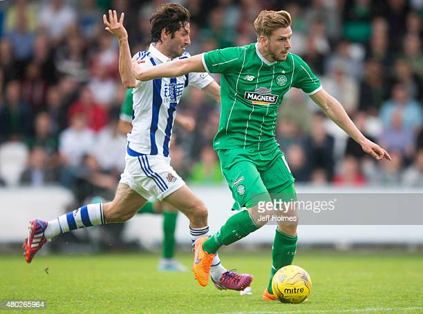 Stuart Armstrong of Celtic holds off Esteban Granero of Real Sociedad at the Pre Season Friendly between Celtic and Real Sociedad at St Mirren Park...