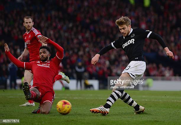 Stuart Armstrong of Dundee United battles with Shay Logan of Aberdeen during the Scottish League Cup SemiFinal match between Dundee United and...