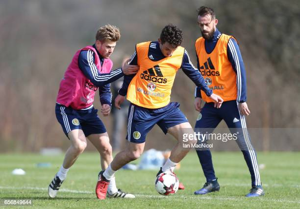 Stuart Armstrong vies with John McGinn during a training session at Mar Hall on March 23 2017 in Erskine Scotland