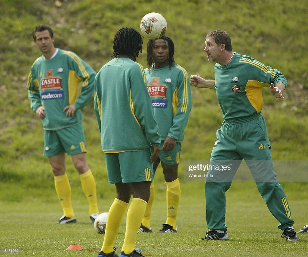 Stuart Baxter the new South African football coach shows his players how it's done during a South African Training Session at Pennyhill Park on April...
