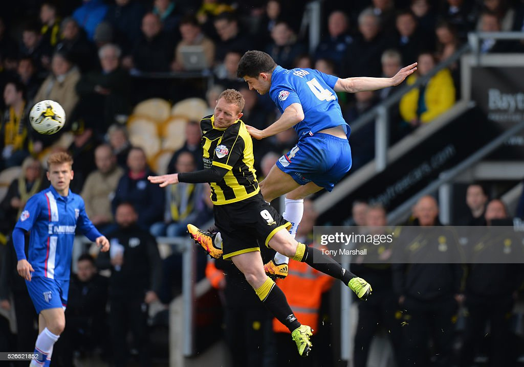 Stuart Beavon of Burton Albion is tackled by John Egan of Gillingham during the Sky Bet League One match between Burton Albion and Gillingham at Pirelli Stadium on April 30, 2016 in Burton-upon-Trent, England.