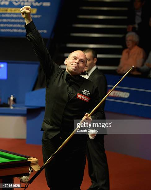 Stuart Bingham celebrates potting frame ball to beat Shaun Murphy in the final of the 2015 Betfred World Snooker Championship at Crucible Theatre on...