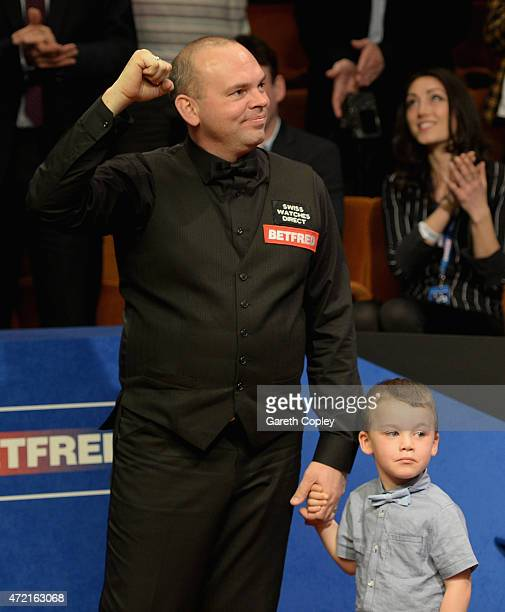 Stuart Bingham celebrates with son Shae after beating Shaun Murphy in the final of the 2015 Betfred World Snooker Championship at Crucible Theatre on...