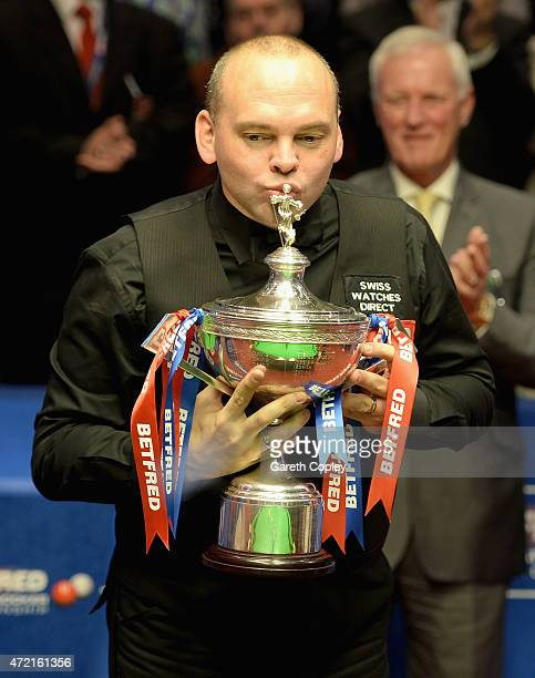 Stuart Bingham lifts the trophy after beating Shaun Murphy in the final of the 2015 Betfred World Snooker Championship at Crucible Theatre on May 4...