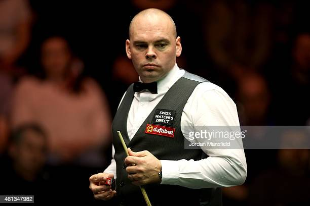 Stuart Bingham of England looks on during his first round match against Marco Fu of Hong Kong on day one of the 2015 Dafabet Masters at Alexandra...