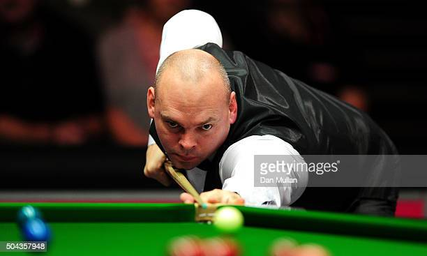 Stuart Bingham of England plays a shot against Ding Junhui of China during Day One of the Dafabet Masters at Alexandra Palace on January 10 2016 in...