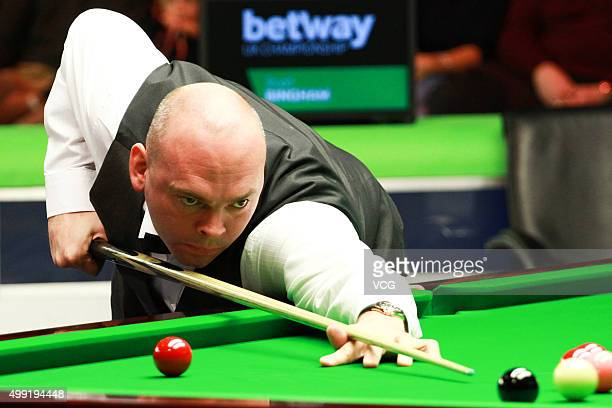 Stuart Bingham of England plays a shot during a match against Anthony Hamilton of England in their second round matches on day four of Betway UK...
