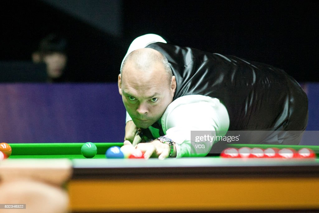 Stuart Bingham of England plays a shot during a qualifying match against Yan Bingtao of China on day one of Evergrande 2017 World Snooker China Champion at Guangzhou Sport University on August 16, 2017 in Guangzhou, Guangdong Province of China.