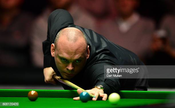 Stuart Bingham of England plays a shot during his quarter final match against John Higgins of Scotland during Day Six of The Dafabet Masters at...