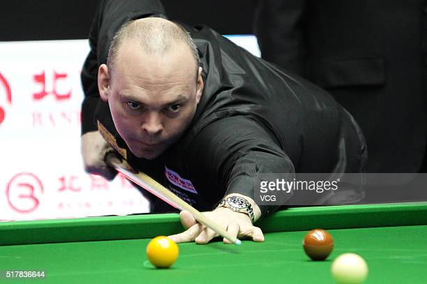 Stuart Bingham of England plays a shot during the qualification match against Cao Yupeng of China on day one of China Open at Students Gymnasium on...
