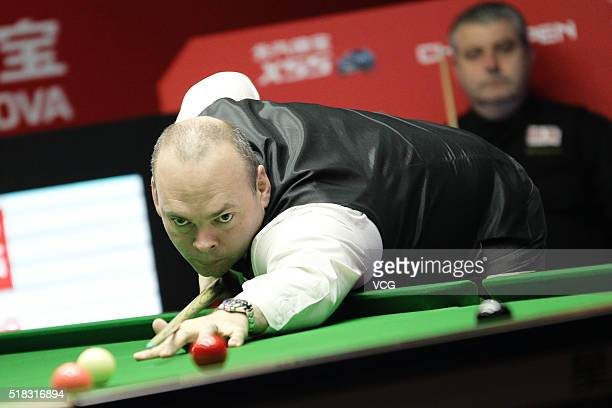 Stuart Bingham of England plays a shot during the third round match against Rod Lawler of England on day four of China Open at Beijing University...
