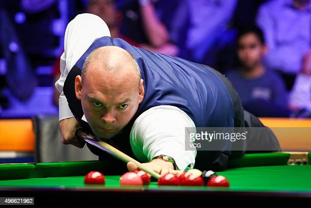 Stuart Bingham of England plays a shot in Group Stage match against Zhou Yuelong of China on day 1 of Champion of Champions 2015 at Ricoh Arena on...