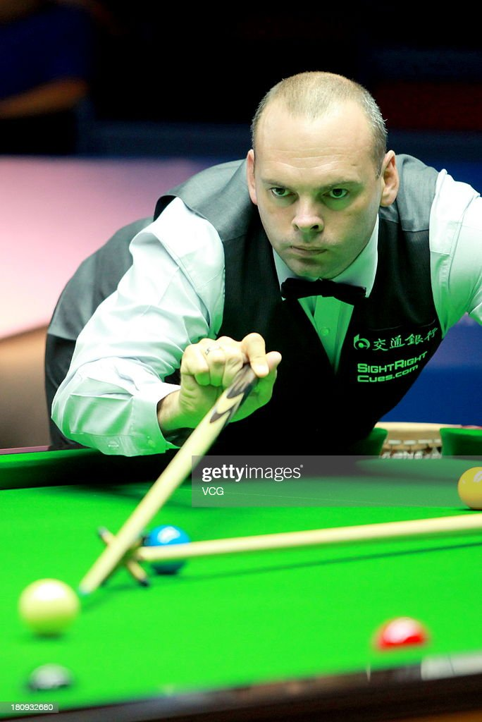 <a gi-track='captionPersonalityLinkClicked' href=/galleries/search?phrase=Stuart+Bingham&family=editorial&specificpeople=795108 ng-click='$event.stopPropagation()'>Stuart Bingham</a> of England plays a shot in the match against Kyren Wilson of England on day three of the 2013 World Snooker Shanghai Master at Shanghai Grand Stage on September 18, 2013 in Shanghai, China.