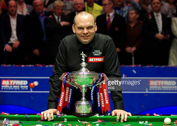 Stuart Bingham of England poses with the trophy after beating Shaun Murphy in the final of the 2015 Betfred World Snooker Championship at Crucible...